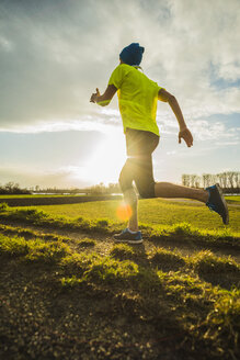 Germany, Mannheim, young man jogging - UUF003646
