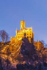 Germany, Baden Wuerttemberg, View of Lichtenstein Castle near Honau in winter, in the evening - WDF002997