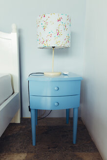 Indonesia, Bali, table lamp and blue bedside cabinet in bedroom of a holiday villa - MBEF001344