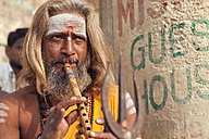 India, Uttar Pradesh, Varanasi, India, Uttar Pradesh, Varanasi, portrait  of a Sadhu playing flute - PC000097