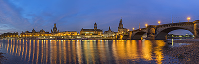 Germany, Dresden, view to lighted city with Elbe River in the foreground in the morning - PVCF000349
