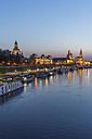 Germany, Dresden, view to lighted old city with Elbe River in the foreground in the evening - PVCF000351