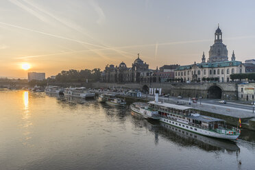 Germany, Dresden, view to city with Elbe River in the foreground at sunrise - PVCF000361
