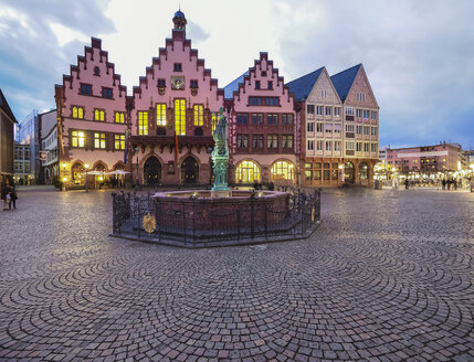 Germany, Hesse, Frankfurt, Roemerberg, Fountain of Justice and old town hall at dusk - AMF003930