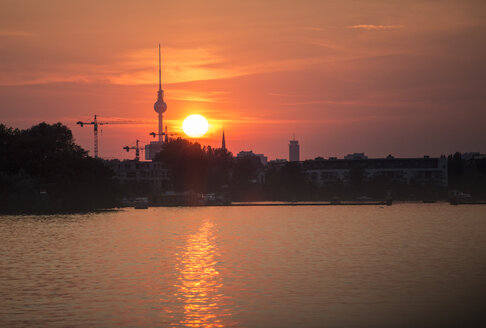Germany, Berlin, view to Spree River at sunset with television tower in the background - ASCF000068