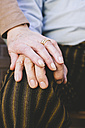 Hand of old woman on husband's hand - GEMF000132