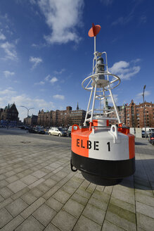 Germany, Hamburg, Hafencity, buoy with buildings of Speicherstadt in background - STE000127