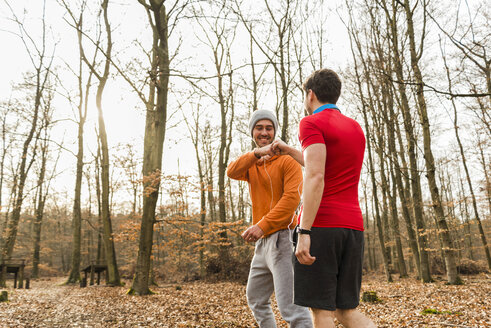 Two sportive young men in forest - UUF003737