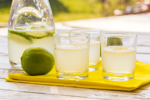 Glasses and carafe of homemade lime lemonade - SARF001557