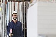 Smiling warehouseman in storehouse - SGF001404