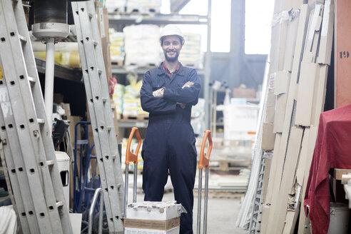 Smiling warehouseman in storehouse - SGF001407