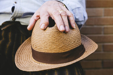 Close-up of old man holding a straw hat - GEMF000145