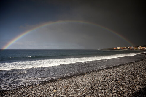 Spain, Canary Islands, La Gomera, Valle Gran Rey, Rainbow over beach and village Playa - PCF000119