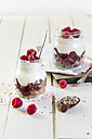 Two glasses of granola dessert with raspberries, yoghurt and quinoa - SBDF001698