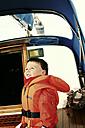 Boy in life jacket on sailing boat, Travemünde, Schleswig-Holstein, Germany - SBD002775