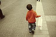 Boy with shopping bag, Düsseldorf, North Rhine-Westphalia, Germany - SBD002778