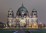 Germany, Berlin, view to lighted Berliner Dom with television tower in the background - KEBF000100