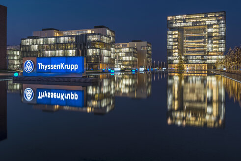 Germany, Essen, view to lighted headquarter of ThyssenKrupp by night - KEB000102