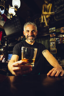 Portrait of man working in an Irish pub - MBEF001390