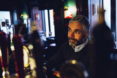 Smiling man in a pub - MBEF001365