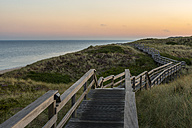 Germany, Schleswig-Holstein, Sylt, Wenningstedt, wooden boardwalk in the evening - KEBF000111