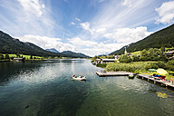 Austria, Carinthia, people in boat on lake Weissensee - HH005242