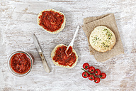 Spreading home-baked pita bread with pizza sauce - EVGF001442