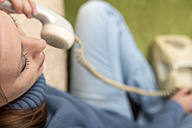 Woman telephoning with vintage phone - MIDF000236