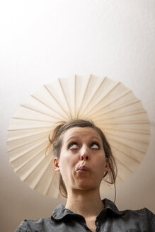 Woman under ceiling lamp as hat - MIDF000241