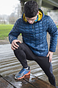 Spain, Galicia, Naron, jogger stretching after training - RAEF000122
