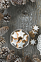 Cup of cinnamon stars and Christmas decoration - ASF005521