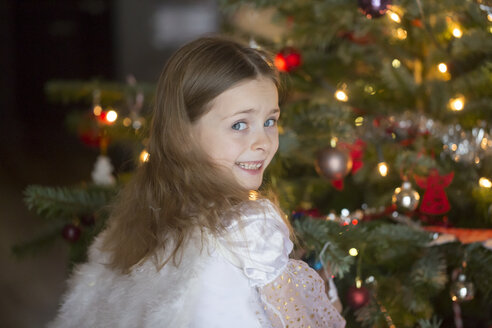 Portrait of little girl with angle wings at Christmas time - SARF001619