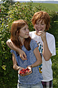Brother and sister with fresh raspberries - LBF001107