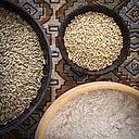 Bowls of rye grains, buckwheat grains and whole grain wheat flour - DISF001468