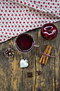 Glass of mulled wine, christmas bauble, apple, cloth, cinnamon sticks and cinnamon stars - LVF003121