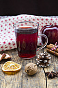Glass of mulled wine, apple, cloth, walnut, cinnamon sticks and cinnamon stars - LVF003123