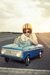 Boy in pedal car on race track - EDF000166