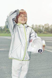 Boy dressed up as spaceman looking up - EDF000152