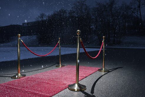 Red carpet on road, snowfall in winter - EDF000140
