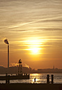 Germany, Bremerhaven, Lighthouse on the pier at sunset - OLEF000048