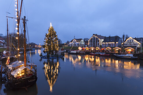 Germany, Lower Saxony, Carolinensiel, harbor with Christmas illumination - WIF001683