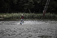 Germany, Garbsen, wakeboarder at Blue Lake - GCF000053
