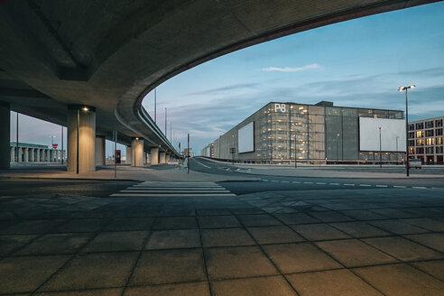 Germany, Brandenburg, view to parking garage of Berlin Brandenburg Airport with underpass in the foreground - ASCF000077