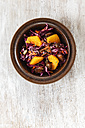 Bowl of red cabbage salad with orange slices, carrots and dates - EVGF001554