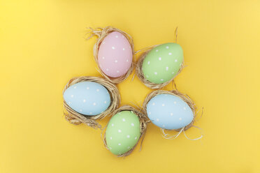 Coloured Easter eggs with polka dots on yellow ground - BZF000118