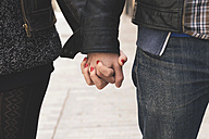 Man and woman holding hands on the street - GEMF000177