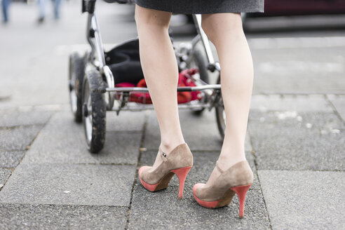 Woman with pram wearing high heels - CHPF000135