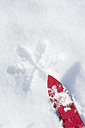 Germany, red children's ski on snow - ASF005555