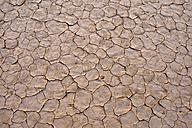 Algeria, Tassili n' Ajjer, broken surface of a salt and clay pan at Sahara - ESF001561