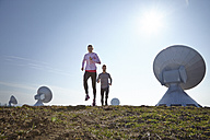 Germany, Raisting, young couple jogging at ground station - KDF000705